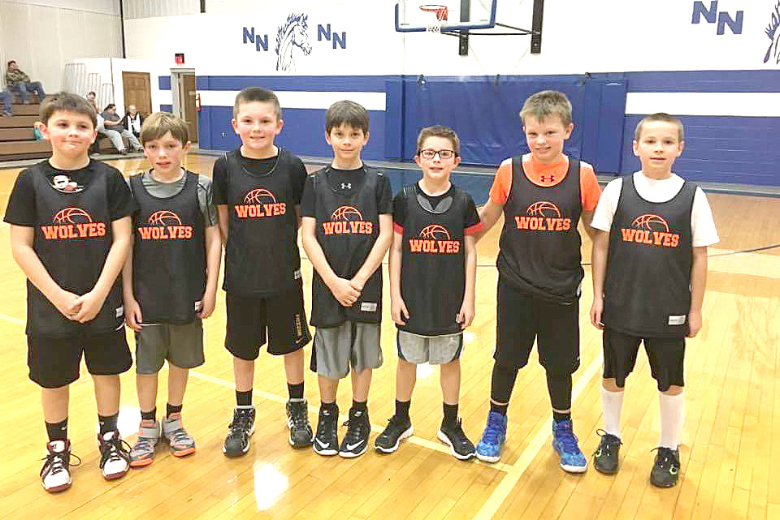 THE EAST ATCHISON WOLVES' 4TH GRADE TEAM